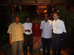 Dinner Saturday, Archbishop Emmanuel Kolini is far left